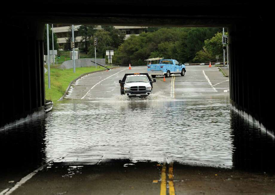 A traffic control vehicle transits a flooded underpass in San Rafael, Calif., on Sunday, Dec. 2, 2012. Days of heavy rains have left the region saturated and several rivers are expected to flood their banks Sunday afternoon. (AP Photo/Noah Berger) Photo: Noah Berger