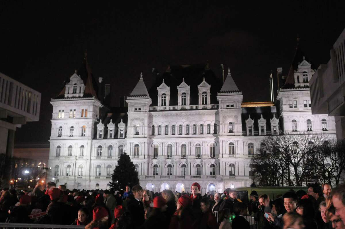 People stand outside the capitol as they wait for the tree to be lit at the Empire State Plaza during the lighting of the State Christmas Tree on Sunday, Dec. 2, 2012 in Albany, NY. (Paul Buckowski / Times Union)
