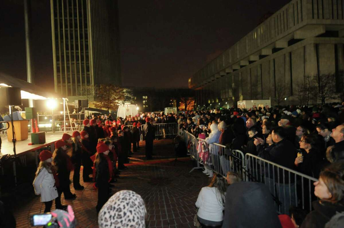 Members of The Music Studio, an Albany music school, sing Christmas songs at the Empire State Plaza during the lighting of the State Christmas Tree on Sunday, Dec. 2, 2012 in Albany, NY. (Paul Buckowski / Times Union)