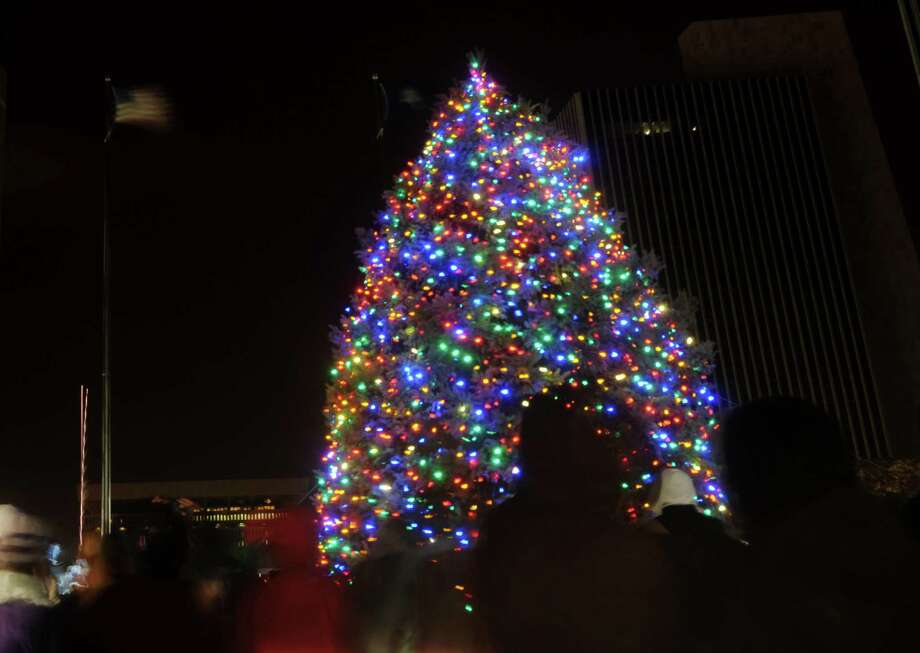 The lights on the tree are turned on at the Empire State Plaza during the lighting of the State Christmas Tree on Sunday, Dec. 2, 2012 in Albany, NY.    (Paul Buckowski / Times Union) Photo: Paul Buckowski  / 10020298A