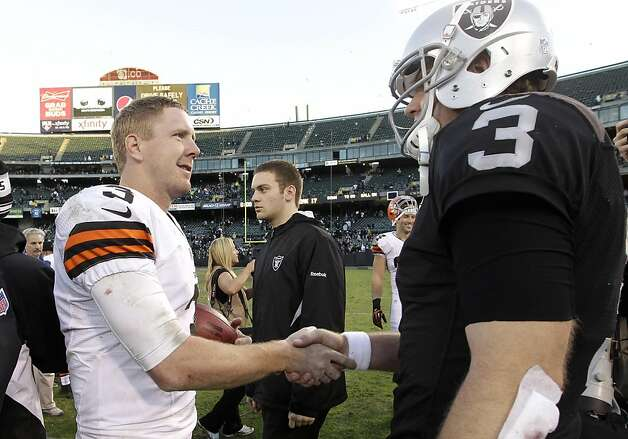 Cleveland Browns quarterback Brandon Weeden, left, greets Oakland Raiders quarterback Carson Palmer after an NFL football game in Oakland, Calif., Sunday, Dec. 2, 2012. The Browns won 20-17. (AP Photo/Marcio Jose Sanchez) Photo: Tony Avelar, Associated Press