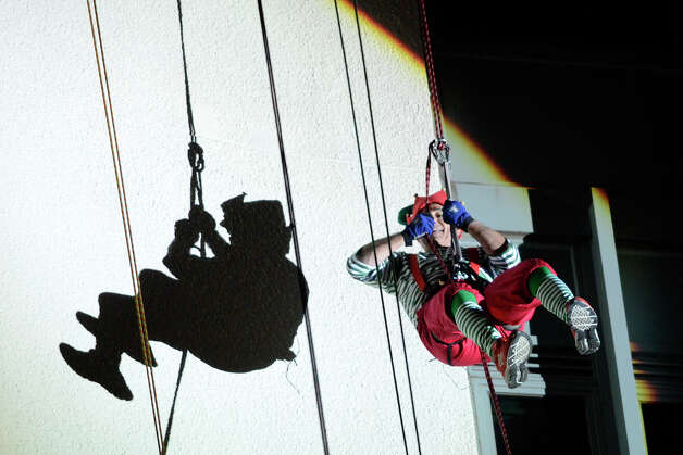 Bobby Valentine rappels down the side of the Landmark Building in downtown Stamford, CT. He joined Brian Cashman, Santa, Rudolph and Mrs. Claus in a holiday rappelling celebration on Dec. 2, 2012. Photo: Shelley Cryan / Shelley Cryan for the Stamford Advocate/ freelance Shelley Cryan