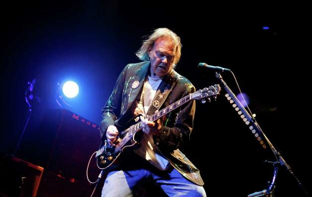 FILE - In this Monday, Dec. 15, 2008, file photo, Neil Young performs at Madison Square Garden in New York. Neil Young said, Sunday, Dec. 2, 2012, he couldn't see performing in the area devastated by Superstorm Sandy without doing something to help people who were affected by it. Young and his longtime backing band, Crazy Horse, will be near Atlantic City's devastated boardwalk for a benefit concert Thursday. (AP Photo/Jason DeCrow, File) Photo: Jason DeCrow