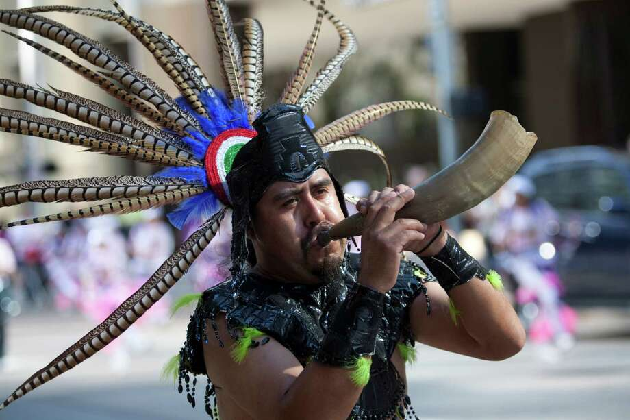 "Angel Longinos blows a horn during a march through downtown Dec. 2, 2012 in Houston. in an expression of devotion and thanks-giving to  Guadalupe, the Patroness of the Americas, matachines dance and celebrate, and march Dec. 2, 2012 in Houston through the streets of downtown. Now in its 37th year, this is the annual city-wide celebration of the Feast of Our Lady of Guadalupe. The day unites people from across the Archdiocese of Galveston-Houston as thousands come together to rejoice. The event began at noon with a procession from 1700 San Jacinto to the George R. Brown Convention Center. Matachines are indigenous folk dance troupes, mariachis and other singers. The matachines wear elaborate headpieces and traditional Aztec-style dress.  From a press release: ""This celebration in the Hispanic Catholic community means being able to maintain a cultural heritage that derives almost 5 centuries,"" said Gilberto Heredia, president of the Guadalupana Association.  The general community is invited to this annual event.  The event is sponsored by the Guadalupana Association of the Archdiocese of Galveston-Houston. It commemorates the official Church feast day of Our Lady of Guadalupe on December 12. On a hill near a rural village just outside of Mexico City, the Virgin Mary, Our Lady of Guadalupe, appeared to a humble peasant named Juan Diego, now St. Juan Diego. Surrounded by light and speaking in his indigenous tongue of Nahuatl, Our Lady told Juan Diego she wanted a church built to manifest her Son's love and hear the petitions of the faithful. To help him in his mission, she gave him a sign, imprinting her beautiful image on his cloak. From it would flow miracles. The news spread quickly throughout Mexico, and in the following years, millions would convert to Catholicism. The Archdiocese of Galveston-Houston serves 1.2 million Catholics in 10 counties. It is the largest Roman Catholic diocese in Texas and the 12th largest in the United States. Photo: Eric Kayne / © 2012 Eric Kayne"