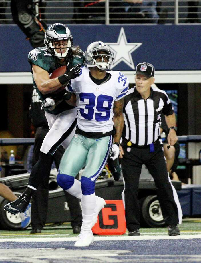 Philadelphia Eagles' wide receiver Riley Cooper catches a pass over Dallas Cowboys' safety Gerald Sensabaugh for a touchdown during the second half at Cowboys Stadium in Arlington, Texas, Sunday, Dec. 2, 2012. Photo: Jerry Lara, San Antonio Express-News / © 2012 San Antonio Express-News