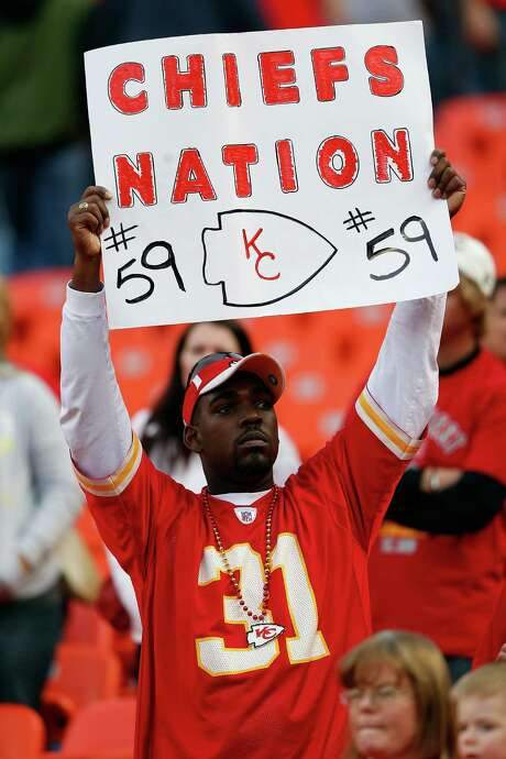A Chiefs fan shows his support for linebacker Jovan Belcher on Sunday. Police say Belcher shot and killed his girlfriend and then shot himself to death at the team's practice facility a day earlier. Photo: Jamie Squire, Staff / 2012 Getty Images