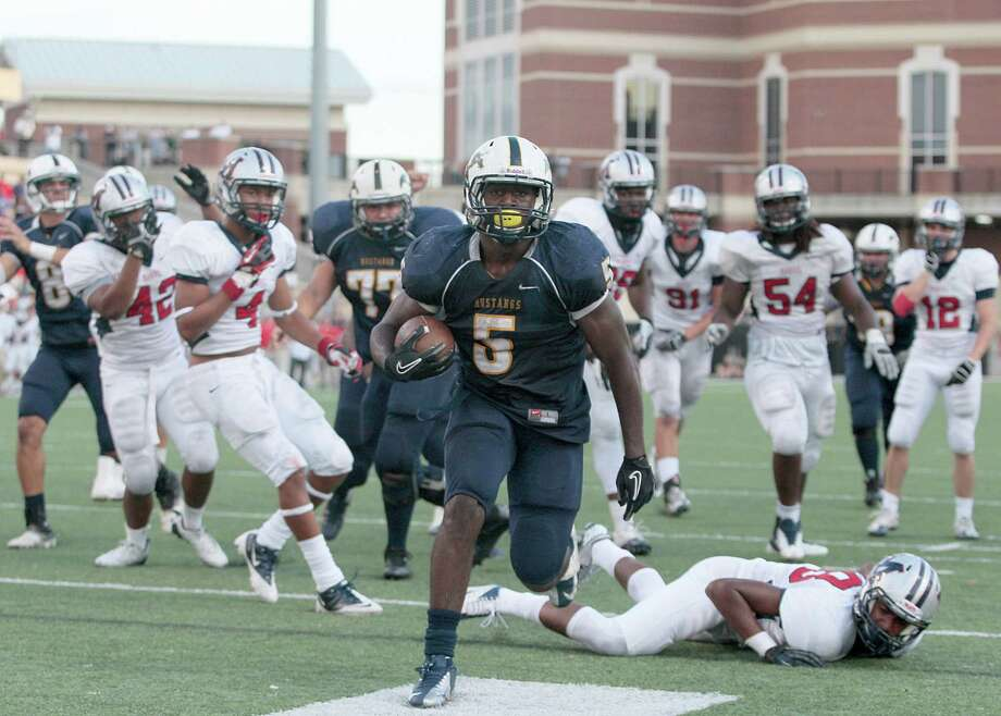 12/1/12 : Cypress Ranch Mustangs running back Keith Ford rushes for a touchdown that tied the game late in the fourth quarter against the Manvel Mavericks in a Class 5 A Division II playoff game at the Berry Center inCypress, Texas. Cypress Ranch won 43 to 42. Photo: Thomas B. Shea / © 2012 Thomas B. Shea