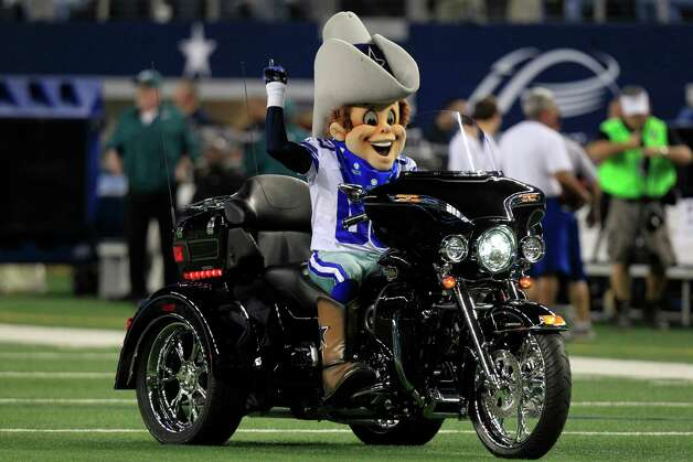 Dallas Cowboys mascot Rowdy rides a motorcycle before theNFL football game between the Philadelphia Eagles and Dallas Cowboys Sunday, Dec. 2, 2012 in Arlington, Texas. (AP Photo/LM Otero) Photo: LM Otero, Associated Press / AP