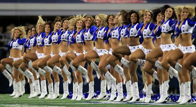 Dallas Cowboys cheerleaders perform before the NFL football game between the Philadelphia Eagles and Dallas Cowboys Sunday, Dec. 2, 2012 in Arlington, Texas. (AP Photo/LM Otero) Photo: LM Otero, Associated Press / AP