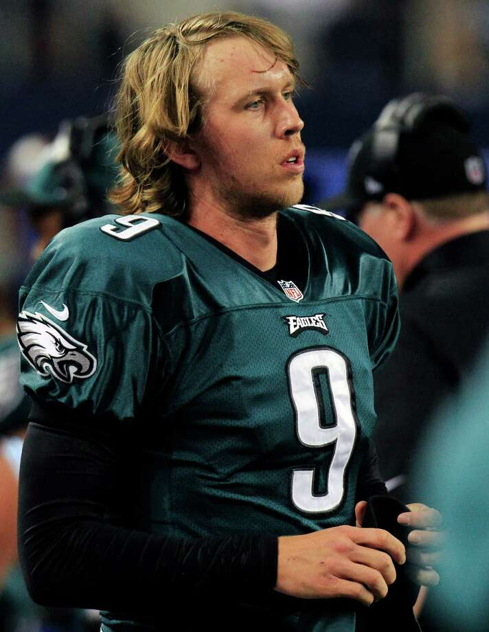 Philadelphia Eagles quarterback Nick Foles (9) watches action against the Dallas Cowboys during the second half of an NFL football game Sunday, Dec. 2, 2012 in Arlington, Texas. Dallas won 38-33. (AP Photo/LM Otero) Photo: LM Otero, Associated Press / AP