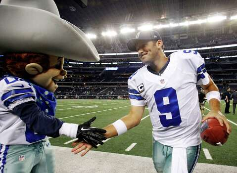 Dallas Cowboys quarterback Tony Romo (9) celebrates with team mascot Rowdy after defeating the Philadelphia Eagles 38-33 in an NFL football game Sunday, Dec. 2, 2012 in Arlington, Texas. (AP Photo/Tony Gutierrez) Photo: Tony Gutierrez, Associated Press / AP