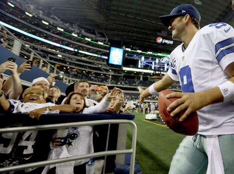 Dallas Cowboys quarterback Tony Romo (9) celebrates with fans after beating the Philadelphia Eagles 38-33 at NFL football game Sunday, Dec. 2, 2012 in Arlington, Texas.  (AP Photo/LM Otero) Photo: LM Otero, Associated Press / AP