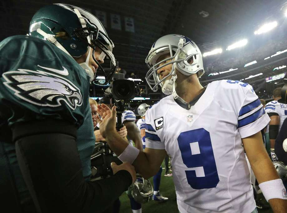 Dallas Cowboys quarterback Tony Romo (9) greets Philadelphia Eagles quarterback Nick Foles (9) after their NFL football game Sunday, Dec. 2, 2012 in Arlington, Texas.  The Cowboys won 38-33. (AP Photo/LM Otero) Photo: LM Otero, Associated Press / AP
