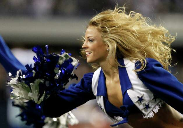 A member of the Dallas Cowboys cheerleaders performs during an NFL football game against the Philadelphia Eagles Sunday, Dec. 2, 2012, in Arlington, Texas. (AP Photo/Tony Gutierrez) Photo: Tony Gutierrez, Associated Press / AP