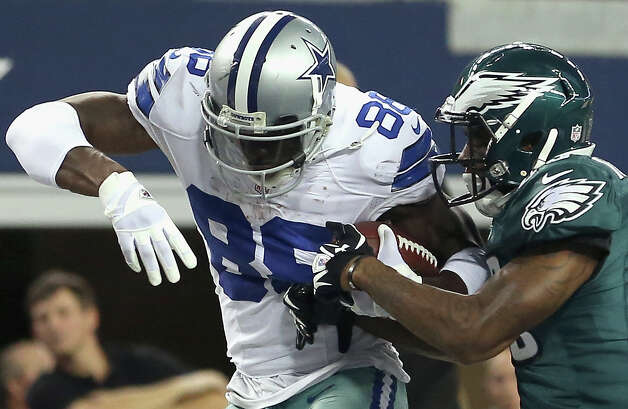 ARLINGTON, TX - DECEMBER 02:  Dez Bryant #88 of the Dallas Cowboys scores a touchdown against  Dominique Rodgers-Cromartie #23 of the Philadelphia Eagles at Cowboys Stadium on December 2, 2012 in Arlington, Texas. Photo: Ronald Martinez, Getty Images / 2012 Getty Images