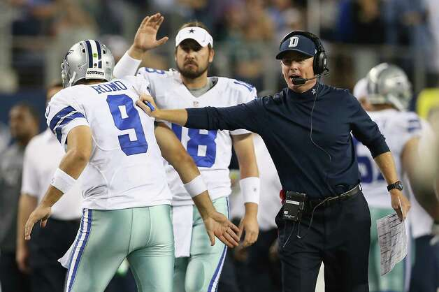 ARLINGTON, TX - DECEMBER 02:  Tony Romo #9 of the Dallas Cowboys celebrates a touchdown with Jason Garrett during play against the Philadelphia Eagles at Cowboys Stadium on December 2, 2012 in Arlington, Texas. Photo: Ronald Martinez, Getty Images / 2012 Getty Images