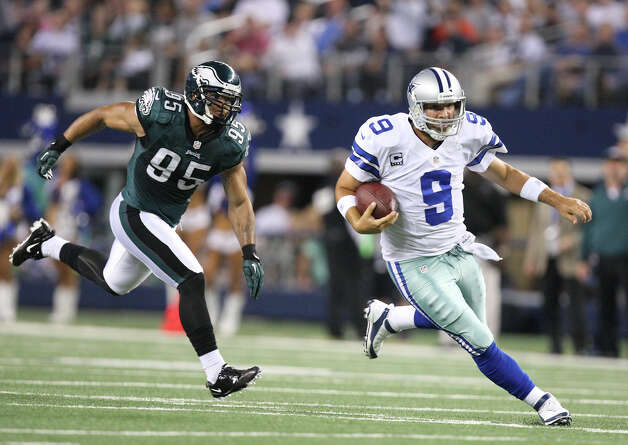 Dallas Cowboys' quarterback Tony Romo scrambles for a first down as he is chased by Philadelphia Eagles' linebacker Mychal Kendricks during the first half at Cowboys Stadium in Arlington, Texas, Sunday, Dec. 2, 2012. Photo: Jerry Lara, San Antonio Express-News / © 2012 San Antonio Express-News