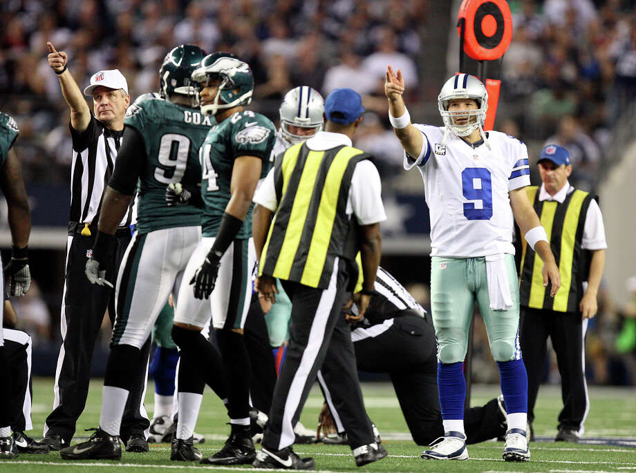 Dallas Cowboys' quarterback Tony Romo agrees with the official's call after a challenge by Head Coach Jason Garrett during the second half against the Philadelphia Eagles at Cowboys Stadium in Arlington, Texas, Sunday, Dec. 2, 2012. Photo: Jerry Lara, San Antonio Express-News / © 2012 San Antonio Express-News