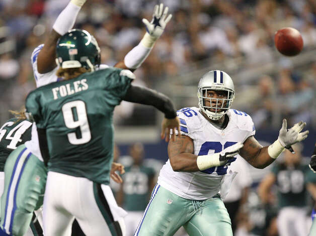 Dallas Cowboys' defensive tackle Marcus Spears attempts to block a pass from Philadelphia Eagles' quarterback Nick Foles during the second half at Cowboys Stadium in Arlington, Texas, Sunday, Dec. 2, 2012. Photo: Jerry Lara, San Antonio Express-News / © 2012 San Antonio Express-News