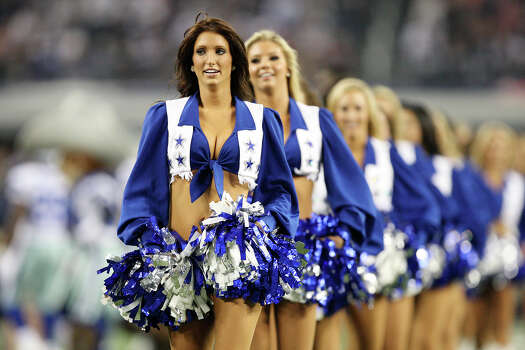 The Dallas Cowboys cheerleaders perform during a break against the Philadelphia Eagles at Cowboys Stadium in Arlington, Texas, Sunday, Dec. 2, 2012. Photo: Jerry Lara, San Antonio Express-News / © 2012 San Antonio Express-News
