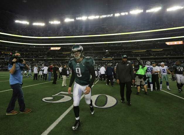 Philadelphia Eagles quarterback Nick Foles (9) runs off the field after the loss to the Dallas Cowboys after an NFL football game Sunday, Dec. 2, 2012 in Arlington, Texas. (AP Photo/LM Otero) Photo: LM Otero, Associated Press / AP
