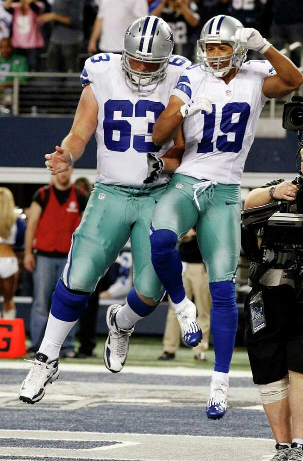 Dallas Cowboys wide receiver Miles Austin (19) celebrates with Ryan Cook (63) after scoring a touchdown against the Philadelphia Eagles during the second half of an NFL football game, Sunday, Dec. 2, 2012, in Arlington, Texas. (AP Photo/Tony Gutierrez) Photo: Tony Gutierrez, Associated Press / AP