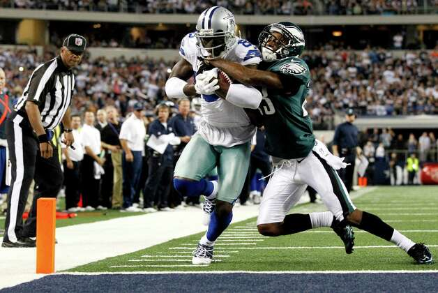 Dallas Cowboys wide receiver Dez Bryant (88) scores a touchdown as Philadelphia Eagles cornerback Dominique Rodgers-Cromartie (23) defends during the second half of an NFL football game, Sunday, Dec. 2, 2012, in Arlington, Texas. (AP Photo/Tony Gutierrez) Photo: Tony Gutierrez, Associated Press / AP