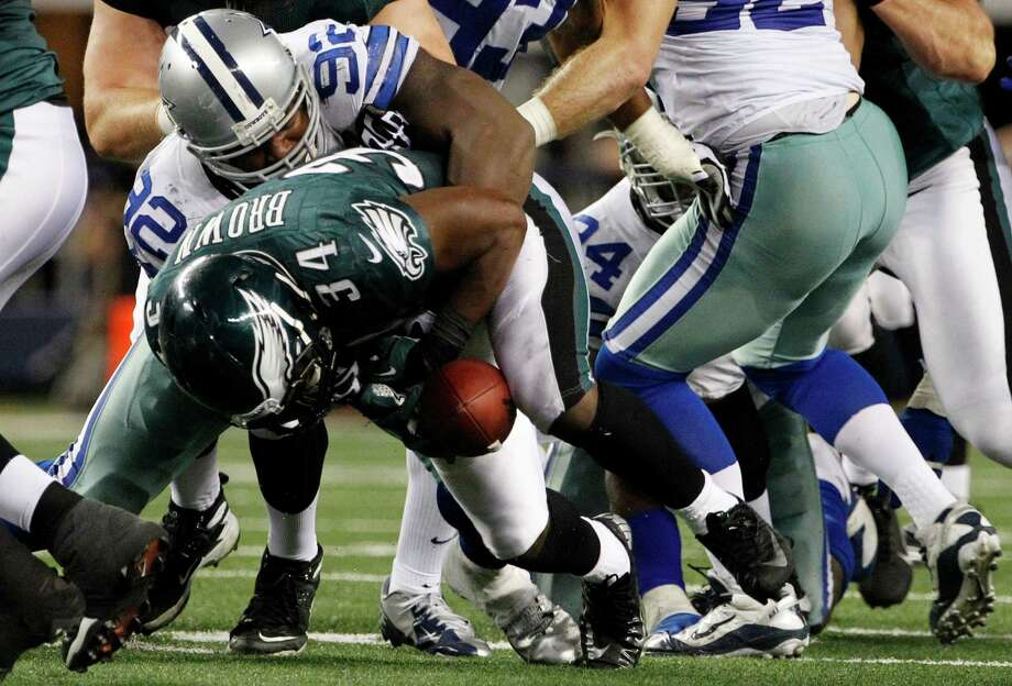 Dallas Cowboys nose tackle Josh Brent (92) causes Philadelphia Eagles running back Bryce Brown (34) to fumble the ball during the second half of an NFL football game Sunday, Dec. 2, 2012 in Arlington, Texas. (AP Photo/Tony Gutierrez) Photo: Tony Gutierrez, Associated Press / AP