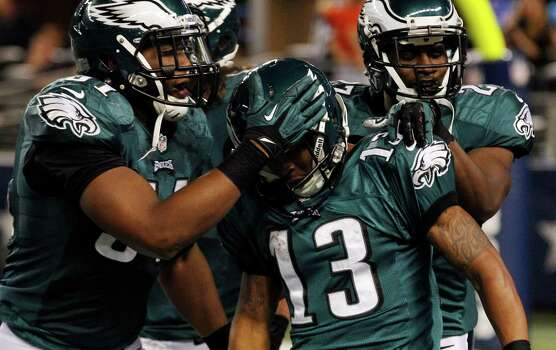 Philadelphia Eagles wide receiver Damaris Johnson (13) celebrates with Jamar Chaney (51), Casey Matthews, and Brandon Hughes (27) after returning a punt for 98 yards for a touchdown during the second half of an NFL football game against the Dallas Cowboys Sunday, Dec. 2, 2012 in Arlington, Texas.(AP Photo/LM Otero) Photo: LM Otero, Associated Press / AP