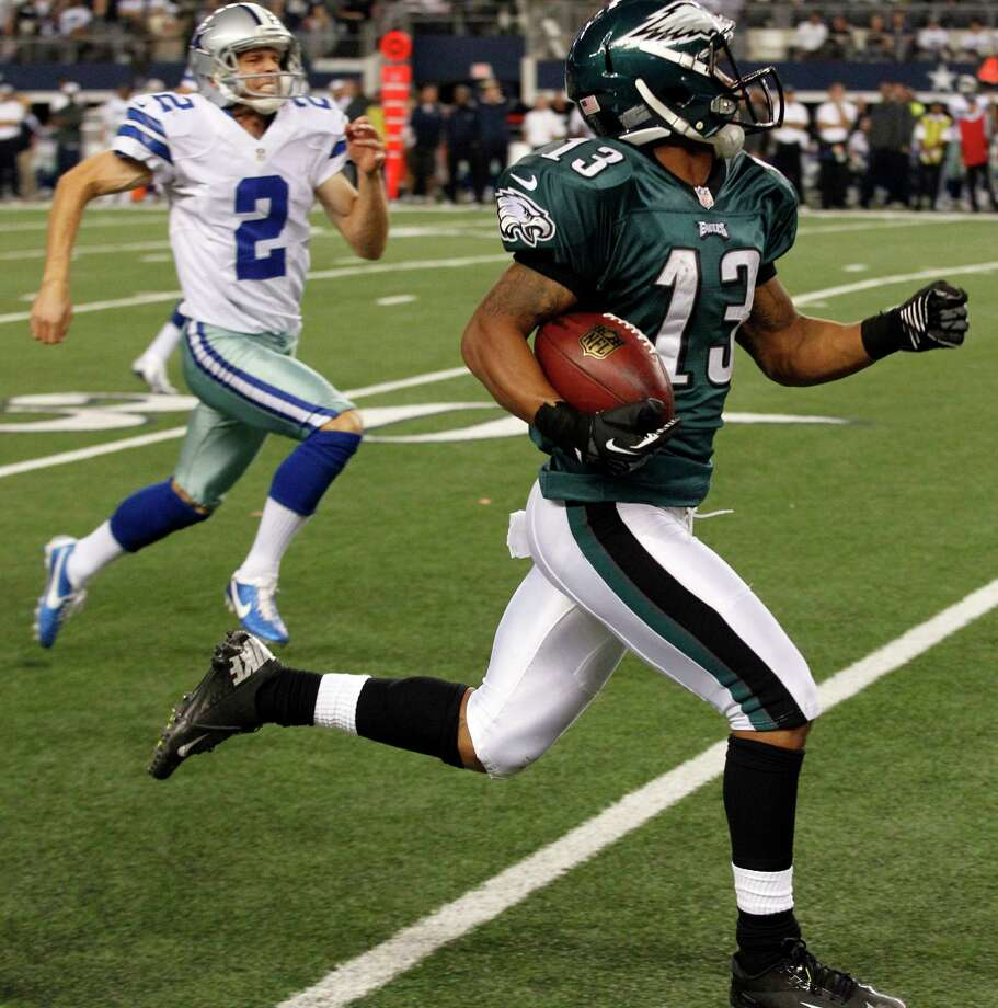 Philadelphia Eagles wide receiver Damaris Johnson (13) makes a 98-yard punt return for a touchdown as Dallas Cowboys punter Brian Moorman (2) pursues during the second half of an NFL football game Sunday, Dec. 2, 2012 in Arlington, Texas.(AP Photo/LM Otero) Photo: LM Otero, Associated Press / AP