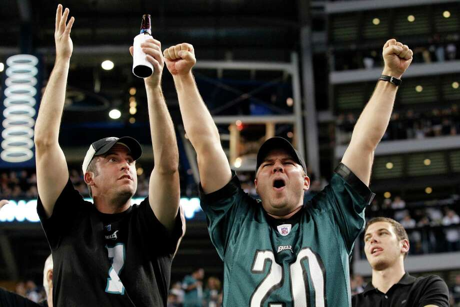 Philadelphia Eagles fans celebrate after wide receiver Riley Cooper (14) scored a touchdown against the Dallas Cowboys during the second half of an NFL football game, Sunday, Dec. 2, 2012, in Arlington, Texas. (AP Photo/Tony Gutierrez) Photo: Tony Gutierrez, Associated Press / AP
