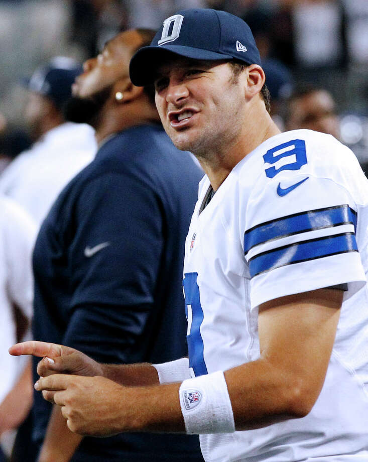 Dallas Cowboys quarterback Tony Romo (9) celebrates on the sideline during the second half of an NFL football game against the Philadelphia Eagles on Sunday, Dec. 2, 2012 in Arlington, Texas. The Cowboys won 38-33. (AP Photo/Tony Gutierrez) Photo: Tony Gutierrez, Associated Press / AP