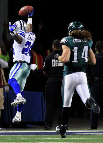 Dallas Cowboys cornerback Morris Claiborne (24) returns a fumble by Philadelphia Eagles running back Bryce Brown for a touchdown during the second half of an NFL football game Sunday, Dec. 2, 2012 in Arlington, Texas. Philadelphia Eagles' Riley Cooper (14) follows. (AP Photo/LM Otero) Photo: LM Otero, Associated Press / AP