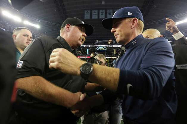 Philadelphia Eagles head coach Andy Reid and Dallas Cowboys head coach Jason Garrett shake hands after their game Sunday, Dec. 2, 2012 in Arlington, Texas.  The Cowboys won 38-33. LM Otero/Associated Press Photo: LM Otero, Associated Press / AP