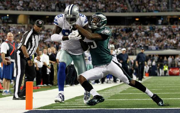 Dallas Cowboys wide receiver Dez Bryant (88) scores a touchdown as Philadelphia Eagles cornerback Dominique Rodgers-Cromartie (23) defends during the second half of an NFL football game Sunday, Dec. 2, 2012 in Arlington, Texas. (AP Photo/Tony Gutierrez) Photo: Tony Gutierrez, Associated Press / AP