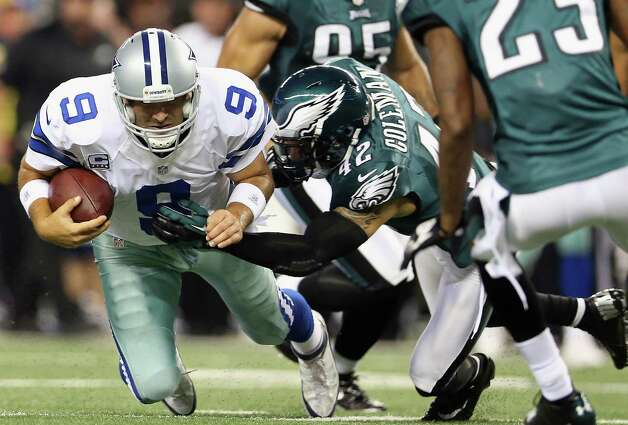 ARLINGTON, TX - DECEMBER 02:  Tony Romo #9 of the Dallas Cowboys runs the ball for a first down against Kurt Coleman #42 of the Philadelphia Eagles at Cowboys Stadium on December 2, 2012 in Arlington, Texas. Photo: Ronald Martinez, Getty Images / 2012 Getty Images