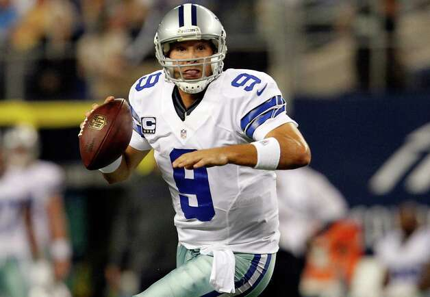 ARLINGTON, TX - DECEMBER 02:  Quarterback Tony Romo #9 of the Dallas Cowboys looks for an open receiver against the Philadelphia Eagles at Cowboys Stadium on December 2, 2012 in Arlington, Texas. Photo: Tom Pennington, Getty Images / 2012 Getty Images