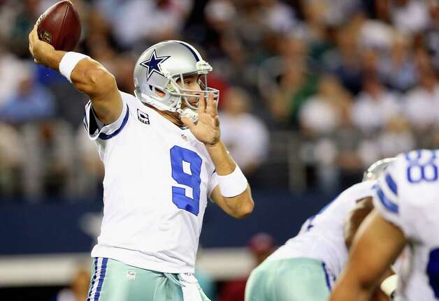 ARLINGTON, TX - DECEMBER 02:   Tony Romo #9 of the Dallas Cowboys throws the ball against the Philadelphia Eagles at Cowboys Stadium on December 2, 2012 in Arlington, Texas. Photo: Ronald Martinez, Getty Images / 2012 Getty Images