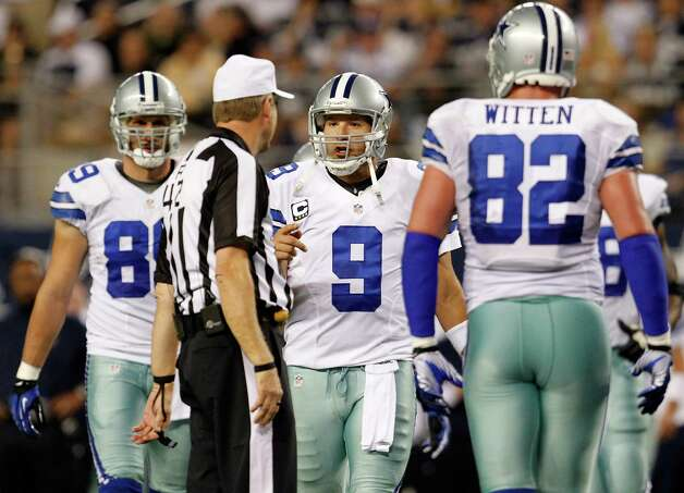 ARLINGTON, TX - DECEMBER 02:  Quarterback Tony Romo #9 of the Dallas Cowboys argues a call with referee Jeff Triplette as the Dallas Cowboys take on the Philadelphia Eagles at Cowboys Stadium on December 2, 2012 in Arlington, Texas. Photo: Tom Pennington, Getty Images / 2012 Getty Images