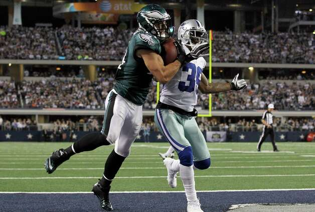 ARLINGTON, TX - DECEMBER 02:  Wide receiver Riley Cooper #14 of the Philadelphia Eagles pulls in a touchdown pass against cornerback Brandon Carr #39 of the Dallas Cowboys to take the lead 24-17 at Cowboys Stadium on December 2, 2012 in Arlington, Texas. Photo: Tom Pennington, Getty Images / 2012 Getty Images