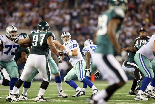 ARLINGTON, TX - DECEMBER 02:   Tony Romo #9 of the Dallas Cowboys throws a touchdown pass to Dez Bryant during play against the Philadelphia Eagles at Cowboys Stadium on December 2, 2012 in Arlington, Texas.  This was the 166th career touchdown pass for Romo making him the all-time Cowboys leader. Photo: Ronald Martinez, Getty Images / 2012 Getty Images