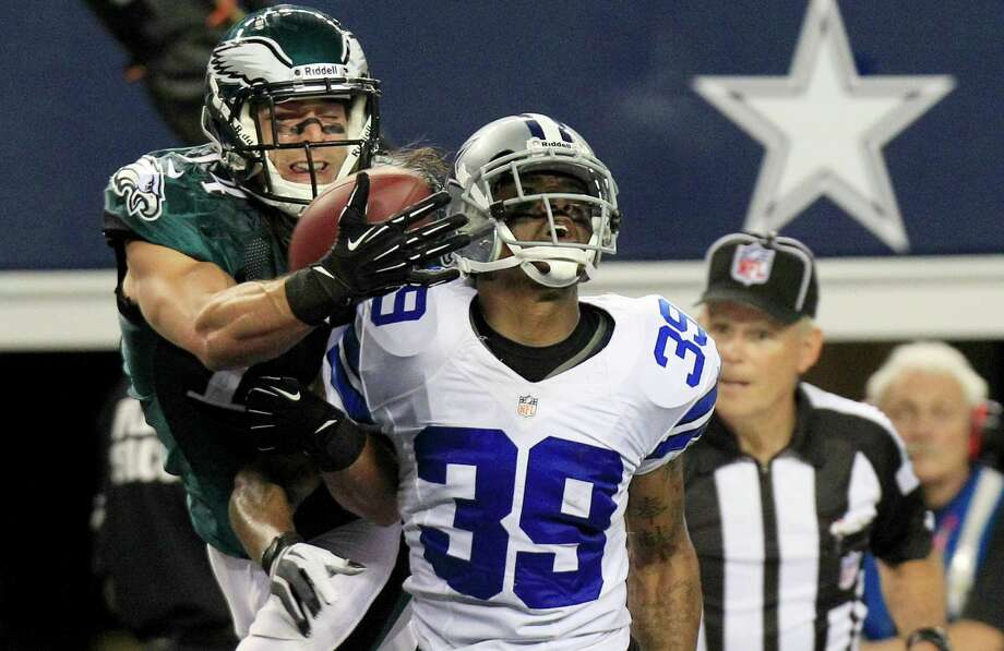 Philadelphia Eagles wide receiver Riley Cooper (14) makes a touchdown reception as Dallas Cowboys cornerback Brandon Carr (39) defends during the second half of an NFL football game Sunday, Dec. 2, 2012 in Arlington, Texas. (AP Photo/LM Otero) Photo: LM Otero, Associated Press / AP