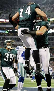 Philadelphia Eagles wide receiver Riley Cooper (14) celebrates with Brent Celek (87) and Stanley Havili (39) after scoring a touchdown against the Dallas Cowboys during the second half of an NFL football game, Sunday, Dec. 2, 2012, in Arlington, Texas. (AP Photo/Tony Gutierrez) Photo: Tony Gutierrez, Associated Press / AP