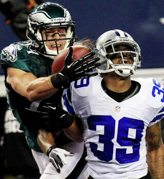 Philadelphia Eagles wide receiver Riley Cooper (14) makes a touchdown reception as Dallas Cowboys cornerback Brandon Carr (39) defends during the second half of an NFL football game, Sunday, Dec. 2, 2012, in Arlington, Texas. (AP Photo/LM Otero) Photo: LM Otero, Associated Press / AP