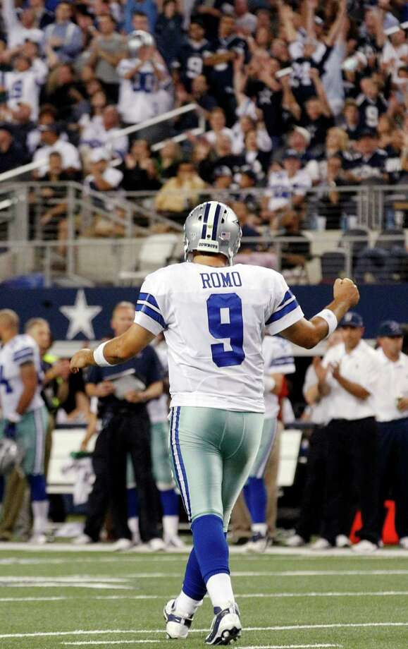 Dallas Cowboys quarterback Tony Romo (9) celebrates a touchdown by DeMarco Murray against the Philadelphia Eagles during the first half of an NFL football game, Sunday, Dec. 2, 2012, in Arlington, Texas. (AP Photo/LM Otero) Photo: LM Otero, Associated Press / AP
