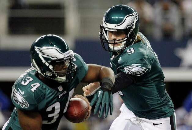 Philadelphia Eagles quarterback Nick Foles (9) hands the ball to Philadelphia Eagles running back Bryce Brown (34) during the first half of an NFL football game against the Dallas Cowboys Sunday, Dec. 2, 2012 in Arlington, Texas. (AP Photo/Tony Gutierrez) Photo: Tony Gutierrez, Associated Press / AP
