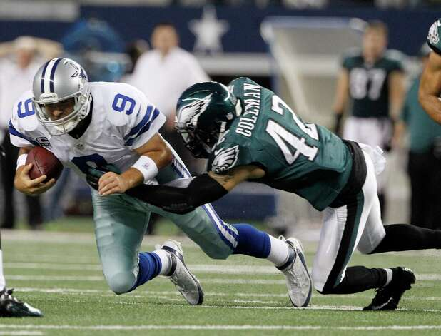 Dallas Cowboys quarterback Tony Romo (9) is tackled by Philadelphia Eagles free safety Kurt Coleman (42) after making a first down during the first half of an NFL football game Sunday, Dec. 2, 2012 in Arlington, Texas.  (AP Photo/Tony Gutierrez) Photo: Tony Gutierrez, Associated Press / AP