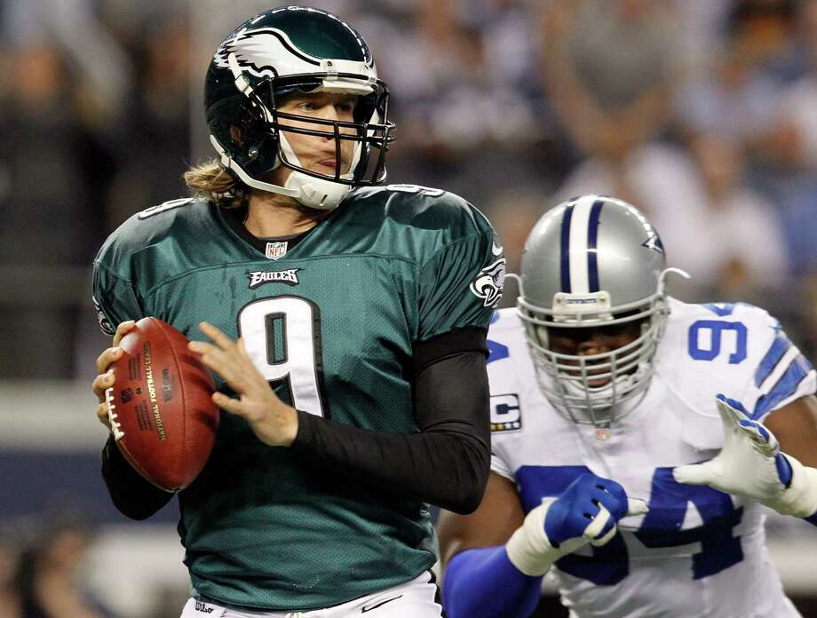 ARLINGTON, TX - DECEMBER 02:  Quarterback Nick Foles #9 of the Philadelphia Eagles looks for an open receiver under pressure from outside linebacker DeMarcus Ware #94 of the Dallas Cowboys at Cowboys Stadium on December 2, 2012 in Arlington, Texas. Photo: Tom Pennington, Getty Images / 2012 Getty Images