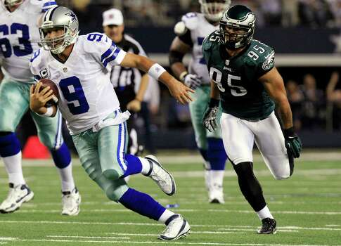 Dallas Cowboys quarterback Tony Romo (9) runs for a first down past Philadelphia Eagles outside linebacker Mychal Kendricks (95) during the first half of an NFL football game, Sunday, Dec. 2, 2012, in Arlington, Texas. (AP Photo/LM Otero) Photo: LM Otero, Associated Press / AP