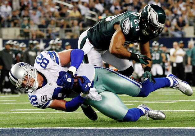 Dallas Cowboys tight end Jason Witten (82) lands for first and goal as Philadelphia Eagles strong safety Nate Allen (29) defends during the first half of an NFL football game, Sunday, Dec. 2, 2012, in Arlington, Texas. (AP Photo/Tony Gutierrez) Photo: Tony Gutierrez, Associated Press / AP